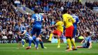 Troy Deeney scores Watford's first goal  during the  Championship match against Brighton  at the AMEX Stadium. Photo: Clive Gee/PA Wire