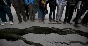 People gather near the cracks on the road caused by an earthquake in Bhaktapur, Nepal. Photograph: Navesh Chitrakar/Reuters.