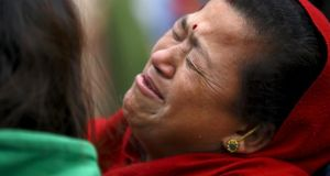 A woman mourns the death of a family member a day after a 7.9 magnitude earthquake in Bhaktapur, Nepal. Photograph: Navesh Chitrakar/Reuters.