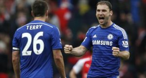 Chelsea's John Terry and Branislav Ivanovic show how much the point gained in draw with Arsenal means to them. Photo: Adrian Dennis/Gety Images