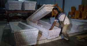 A man prepares coffins before loading them into a truck ahead of the executions of the Bali 9, at Java Christian Church on April 26, 2015 in Cilacap, Central Java, Indonesia. The execution could be held as soon as Tuesday midnight on Nusukamban Island where they have been held, awaiting their fate since March 4th, 2015. Photograph: Ulet Ifansasti/Getty Images