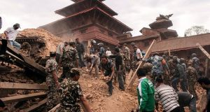 Rescue workers sifting the ruins of a building for survivors in Kathmandu. Photograph: Carl Whetham/IFRC/EPA