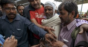 An Indian man with minor injury from the quake is helped by his friends as he queues up for an aircraft at Nepal's Tribhuvan International Airport a day after an earthquake, in Kathmandu, Nepal April 26th. Rescuers dug with their bare hands and bodies piled up in Nepal on Sunday after the earthquake devastated the heavily crowded Kathmandu Valley, killing more than 2,200 people, and triggered a deadly avalanche on Mount Everest. Photograph: Athit Perawongmetha/Reuters