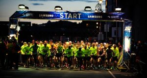 Participants pictured at the start of the Samsung Galaxy S6 Night Run in Dublin City Centre on Sunday night. Photograph: Aidan Crawley
