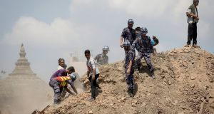 Nepalese police and volunteers clear the rubble while looking for survivors at the compound of a collapsed temple, following Saturday's earthquake, in Kathmandu, Nepal. Photograph: Danish Siddiqui/Reuters