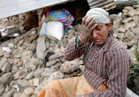 A woman in front of her destroyed home in Kumalpur village, on the outskirts of Kathmandu. Photograph: Narendra  Shrestha/EPA