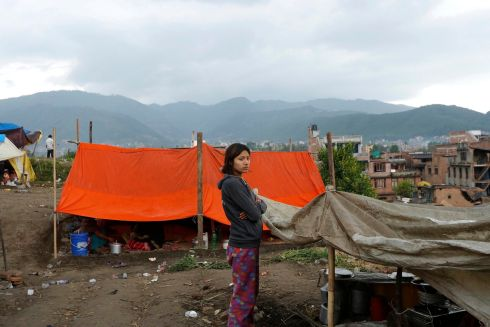 A girl stands in front of their makeshift tent after their house was damaged at Vhaktapur, Nepal.  Photograph: Photograph: Abir Abdullah/EPA