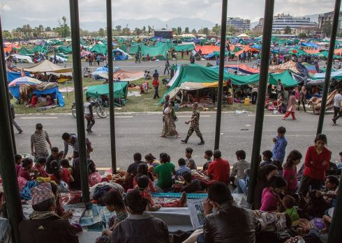 Thousands of residents take shelter in an evacuation area set up in Tundhikel park, Kathmandu.  Photograph: Omar Havana/Getty Images