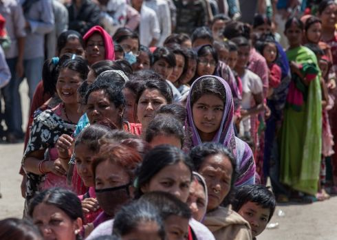 People line up for food in Tundhikel park, Kathmandu.  Photograph: Omar Havana/Getty Images
