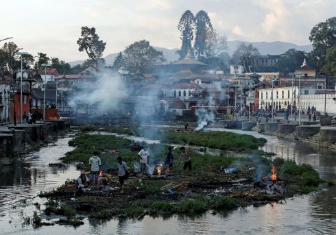 Victims of Saturday's earthquake are cremated along a river in Kathmandu. Photograph: Danish Siddiqui/Reuters