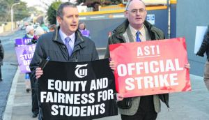 Gerry Quinn, TUI president, and Philip Irwin, Asti president with teachers at Newpark Comprehensive, Co Dublin, on a picket in January. Photograph: Dara Mac Dónaill / The Irish Times