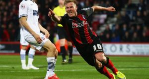Matt Ritchie celebrates after scoring Bournemouth's second against Bolton at the Goldsands Stadium. Photograph: Clive Rose/Getty Images