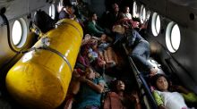 Nepalese victims of Saturday's earthquake lie inside an Indian air force helicopter as they are evacuated from Trishuli Bazar to Kathmandu airport in Nepal. Photograph: AP