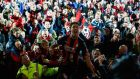 Bournemouth Captain Tommy Elphick and supporters after the Cherries all but secured promotion to the Premier League. Photograph: Getty