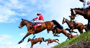 Runners and riders, including eventual winner Wish Ye Didnt ridden by Nina Carberry, clear Ruby's Double during the Kildare Hunt Club Fr Sean Breen Memorial Chase at Punchestown. Photograph: Pat Healy/PA