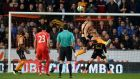 Hull City's Michael Dawson heads home a goal in the Premier League game against Liverpool at   the KC Stadium,   Photo: Martin Rickett/PA Wire