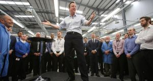 Prime minister David Cameron speaks to workers during a visit to Kelvin Hughes Voltage in Enfield, north London, yesterday. Photograph: Chris Radburn/PA Wire