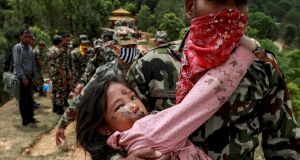 An injured girl is carried by a Nepal Army personnel to a helicopter following Saturday's earthquake. Photograph: Reuters/Danish Siddiqui
