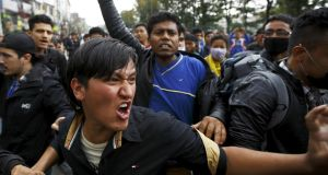 Earthquake victims chant anti-government slogans while protesting against the government's lack of aid provided to the victims in Kathmandu on Wednesday. Photograph: Navesh Chitrakar/Reuters