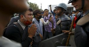 An earthquake victim requests help from a member of the Nepalese Armed Police Force while protesting against the government's lack of aid provided to the victims in Kathmandu on Wednesday. Photograph: Navesh Chitrakar/Reuters