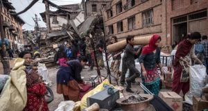 Nepalese victims of the earthquake carry their belongings among debris of homes on April 29th, 2015 in Bhaktapur, Nepal. Photograph: David Ramos/Getty Images