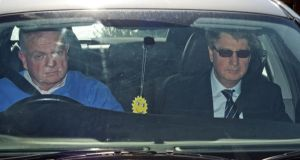 Brian O'Donnell (right) is seen leaving Gorse Hill in a car driven by Jerry Beades.   Photograph: Eric Luke/The Irish Times