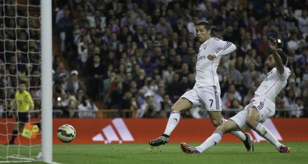 1d938c255 Real Madrid s Alvaro Arbeloa gets a touch before Ronaldo to score his  side s third goal in