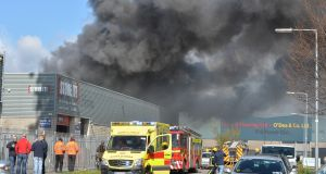 "A spokesman for Dublin Fire Brigade said the level of response required to deal with the blaze in the Ballymount Cross industrial estate had been ""very much on the higher end of the scale"". Photograph: Alan Betson/The Irish Times"