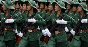 Vietnamese female soldiers of Liberation Force march during a military parade as part of the 40th anniversary of the fall of Saigon in Ho Chi Minh City. Photograph: Kham/Reuters