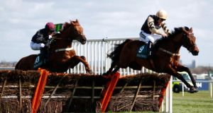 Nichols Canyon, ridden by Ruby Walsh, leads Parlour Games over the last fence in the The World Famous Just Eat Novices Hurdle Race at Aintree Racecourse last month. Photograph: Clive Rose/Getty Images.