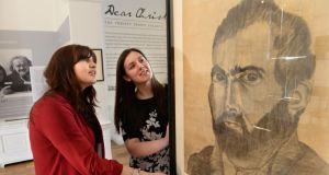 Sarah Costigan, Director of Development, and Joanna Perry, (left) curator of the exhibition, with a self portrait of Christy Brown. Photograph: Dara Mac Dónaill / The Irish Times