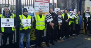 NBRU and Siptu members protest outside the Dublin Bus depot in Summerhill this morning. A picket was placed on the depot at 4am where some 240 drivers work. Photograph: Éanna Ó Caollaí/The Irish Times