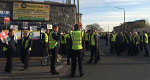 Workers picket the bus depot at Phibsboro this morning. Photograph: Sorcha Pollak/The Irish Times