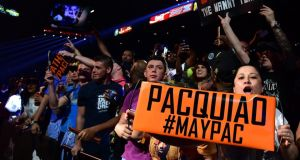 Manny Pacquiao and Floyd Mayweather fans show their support as they await the start of the pre-fight weigh-in on May 1st, 2015 in Las Vegas, Nevada.  Photograph: Getty Images