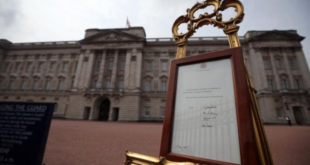 2cf142b466 An easel is placed in the forecourt of Buckingham Palace following the  announcement that Catherine