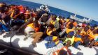 A handout video grab released by the Italian Coast Guard  on Saturday  showing some of 220 shipwrecked migrants being rescued by the Italian coast guard. Photograph: AFP