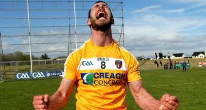Antrim's Neill McManus celebrates a crucial victory over Laois. Photo: John McIlwaine/Inpho