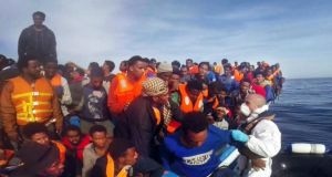 A video image released by the Italian coast guard of a rescue operation of 397 migrants on Saturday. Photograph: AFP/Guardia Costiera
