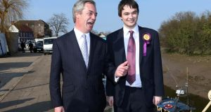 Ukip Leader Nigel Farage with 22-year-old candidate Robin Hunter-Clarke. Mr Hunter-Clarke is running in Boston, Lincolnshire, where support for the party has surged in recent times.  Photograph: Lindsey Parnaby/AFP/Getty Images