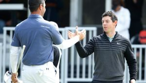 Rory McIlroy shakes hands with Gary Woodland on the 16th hole green after winning their championship match. Photograph: Photograph: Christian Petersen/Getty Image