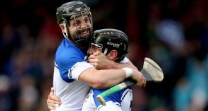 Waterford's Noel Connors and Kevin Moran celebrates at the final whistle of the league final. Photo: James Crombie/Inpho