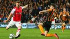 Aaron Ramsey scores Arsenal's second goal despite Hull's Republic of Ireland international Robbie Brady's best efforts. Photograph: Alex Livesey/Getty Images.