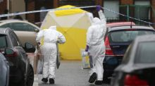 Forensic officers in Welsh Street, in the Markets area near Belfast city centre following the fatal shooting of Gerard 'Jock' Davison, a former IRA commander. Photograph: PA Wire