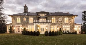 New stone estate house in Belle Haven, Greenwich, Connecticut: The exterior design includes an all-stone veneer with a slate roof and custom windows and doors, and an outside fireplace for spring and autumn. The house covers 7,000sq ft