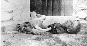 An emaciated Armenian boy lies dead on a doorstep. Photograph: Armin Wegner / Armenian National Institute, courtesy of Sybil Stevens