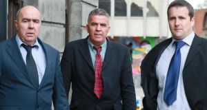 Patrick (left) and Martin O Donnell (centre) and  Patrick Coyle. They have sued the Garda Commissioner and State for damages over being allegedly assaulted by gardaí during a 2007 protest. Photograph: Courts Collins.