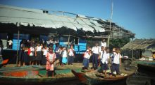 The welcome party for ministry visitors at one of the floating schools on the Tonle Sap Lake, north of Battambang
