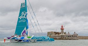 The crew of the Oman multihull celebrate their record breaking Round Ireland voyage off Dún Laoghaire. Photograph: Michael Chester