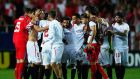 Sevilla's players celebrate after their 3-0 Europa League semi-final first leg win over Fiorentina. Photograph: Getty