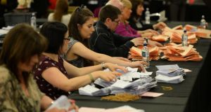 Counting staff sort ballot papers at the counting centre at Doncaster Racecourse,  on Thursday evening. Photograph: AFP
